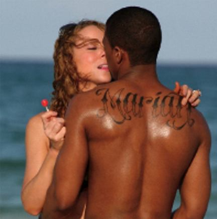 male back tattoos. tattoos of names on ack side