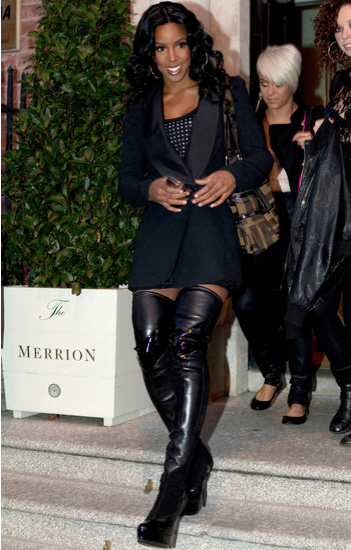 Kelly Rowland steps out in thigh high boots.