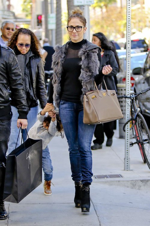 03  Jennifer Lopez's Beverly Hills Black Turtleneck, Fur Vest, Jeans, and Fendi Fendista Suede and Leather Platform Ankle Boots