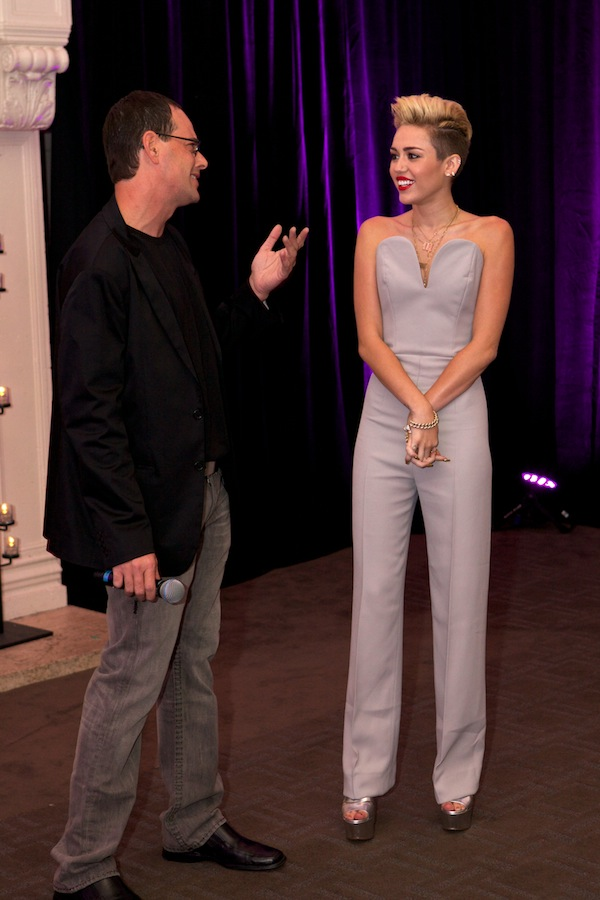 11 Miley Cyrus's Chicago Album Listening Party Maison Martin Margiela Gray Backless Jumpsuit and Prada Silver Sandals