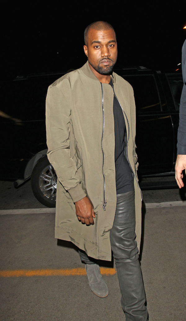 Kanye West is all business as he takes a flight with Kim Kardashian at LAX **USA ONLY**