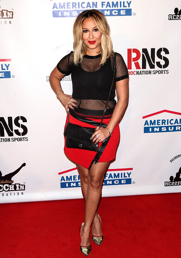 Adrienne-Bailon's-RocNation-Sports-Event-Helmut-Lang-Black-Mesh-Top,-Ohne-Title-Red-Skirt,-and-Christian-Louboutin-Pumps