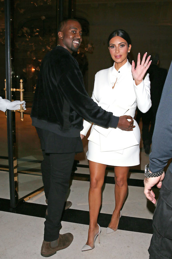 Kim Kardashian and Kanye West gave a friendly wave and smile to photographers as they left the Buro 24/7 Fashion Forward Initiative cocktail event at the Peninsula Hotel in Paris