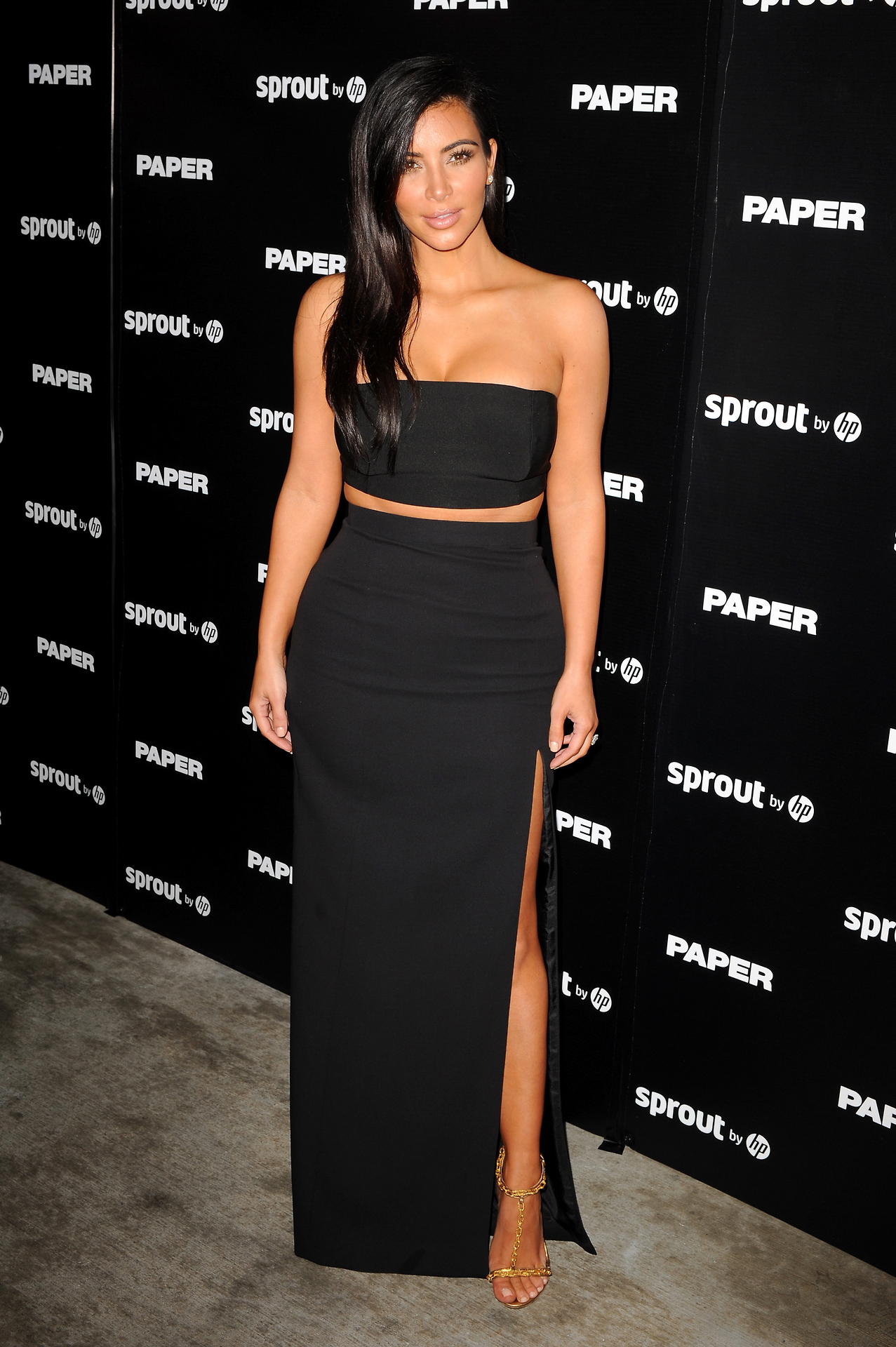 0 9 Kim Kardashian's Art Basel Miami Beach Paper Magazine Dinner Mugler Black Crop Tube Top, J Mendel High Slit Maxi Skirt, and Tom Ford Sandals