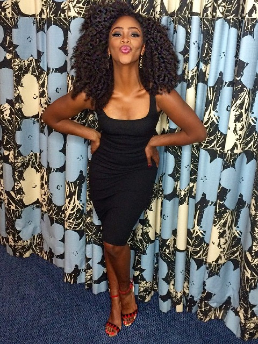 Teyonah Parris blew kisses to her fans on the 'Gram in a body hugging black dress and black and red sandals.