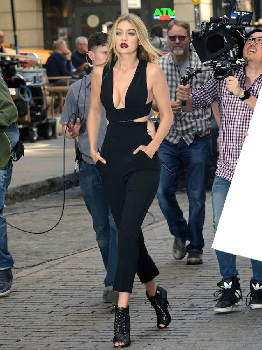 Gigi Hadid worked a chic cut out jumpsuit while on the set of a commercial in NYC. Werk!