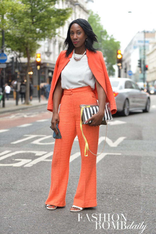 Bright colored suits are always a good idea for the summer. A striped purse added a nice touch.  Image by David Nyanzi